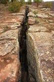 Difetto o fessura nella terra Immagini Stock Libere da Diritti