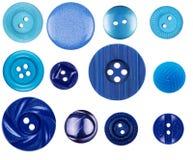Différents boutons bleus sur le fond blanc Photos stock