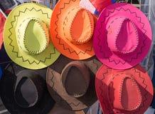Différents chapeaux de cowboy colorés Photo stock
