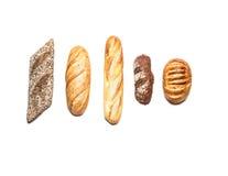 Différents genres de pain sur la vue supérieure blanche Images libres de droits