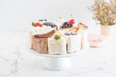 Différents morceaux de gâteau Photographie stock
