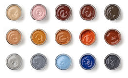 Différents pots de graisse de chaussure de couleur Photographie stock libre de droits