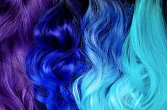 Different hair styles; ombre dyed hair: black to turquoise, blue. To turquoise, black to blue, violet or purple; bright dyed hair, vivid colors, hair salon royalty free stock photo