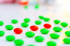 Difference made Leadership :red pigment granules in the green. Royalty Free Stock Image