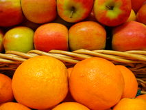 Differences between apples and oranges Royalty Free Stock Images