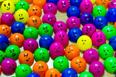 Differences faces on plastic eggs living together.  Stock Photos