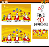 Differences task for children. Cartoon Illustration of Differences Educational Task for Preschool Children with Santa Claus Characters Royalty Free Stock Photos