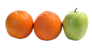 Different. Three pieces of fruit with one being different, isolated against a white background Stock Photography