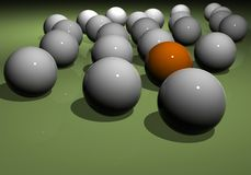 Different. A view of a number of similar gray or white shiny balls with the exception of one orange ball.  Concept:  Difference, non-conformity, alone Royalty Free Stock Image