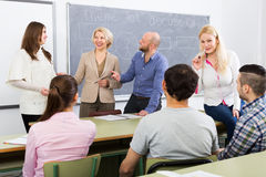 Different age students during break. Different age adult students during break at extension courses Stock Images