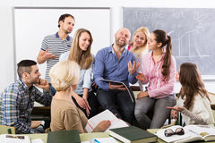 Different age students during break. Different age positive students during break at extension courses Royalty Free Stock Photo