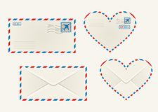 Different airmail envelopes. Set of different airmail envelopes with the front and back of a rectangular and heart shaped envelope blank for your address Royalty Free Stock Photos