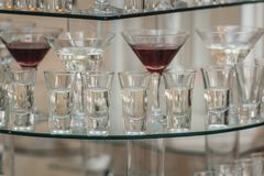 Different alcohol drinks on a glass stand. wine, champagne, cognac, vodka, martini. Different alcohol drinks on a glass stand. wine, champagne, cognac, vodka Royalty Free Stock Photography