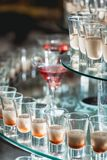 Different alcohol drinks on a glass stand. wine, champagne, cognac, vodka, martini. Different alcohol drinks on a glass stand. wine, champagne, cognac, vodka Stock Image