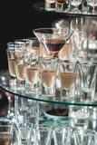Different alcohol drinks on a glass stand. wine, champagne, cognac, vodka, martini. Different alcohol drinks on a glass stand. wine, champagne, cognac, vodka Royalty Free Stock Photos