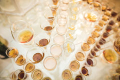 Different alcohol drinks in goblets and wine glasses on wedding buffet table Stock Photo