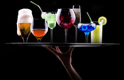 Different alcohol drinks set on a tray Stock Photos
