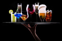 Different alcohol drinks set on a tray. Beer, wine, cocktail,juice, champagne, scotch, soda Stock Image