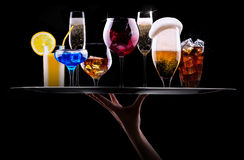 Different alcohol drinks set on a tray Royalty Free Stock Image