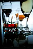 Different Alcoholic Drinks in glass and goblets Stock Image