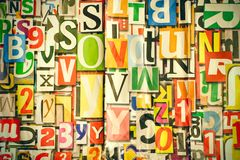 Different alphabet, letters and numbers as background. On wall Royalty Free Stock Photos