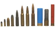 Different ammos - isolated. Several kind bullets - (revolver - shot gun Royalty Free Stock Photography