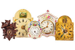 Different ancient clocks isolated on white Royalty Free Stock Photos