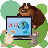 Different animals around big notebook. Different animals around notebook with 2013 New Year Royalty Free Stock Photo