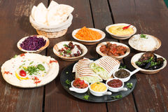 Different appetizer and anti pasti. Typical italian anti pasti on wood table stock image