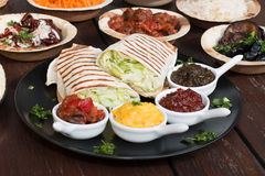 Different appetizer and anti pasti. Typical italian anti pasti on wood table Royalty Free Stock Photos