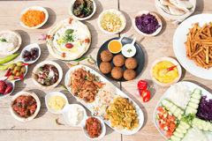 Different appetizer and anti pasti. Typical italian anti pasti on wood table royalty free stock image