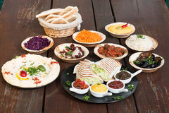 Different appetizer and anti pasti. Typical italian anti pasti on wood table royalty free stock photo