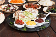 Different appetizer and anti pasti. Typical Turkish anti pasti on wood table royalty free stock images