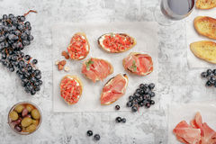 Different appetizers for wine with red wine Royalty Free Stock Photos