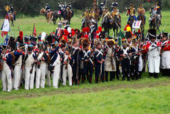 Different army divisions at Borodino battle historical reenactment in Russia. BORODINO, MOSCOW REGION - SEPTEMBER 04, 2016: Reenactors dressed as Napoleonic war royalty free stock photos