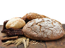 Different assortment fresh bread and wheat ears Royalty Free Stock Photography