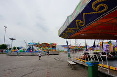 Luna park attractions. Different attractions at a luna park on a cloudy day in Poznan, Poland Stock Photos