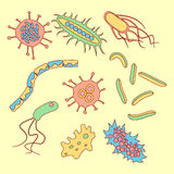 Different bacteria types. Set in bright colors. Stock vector illlustration in funny cartoon style Stock Photos