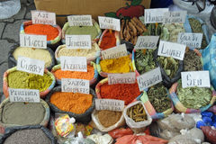 Different bags of colored spices Stock Images