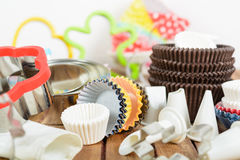 Different baking accessories over wooden background Stock Images