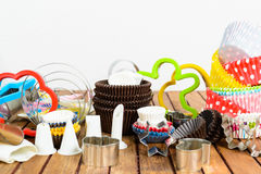 Different baking accessories over wooden background Stock Image