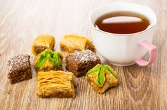Different baklava, cup with tea on table royalty free stock photos