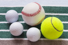 Different balls on a striped towel. Ifferent balls on a striped towel Royalty Free Stock Photos
