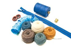 Different balls of yarn and blue meter Royalty Free Stock Photography