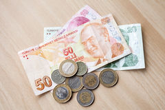 Different banknotes and coins. Turkish national money Stock Photos
