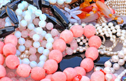 Different beads. Close up of different beads made of corals, pearls and gems Royalty Free Stock Photo