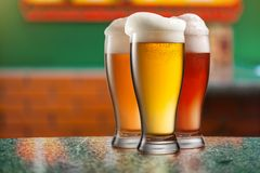 Different beer in glasses in pub Royalty Free Stock Photography