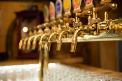 Different beer taps in a row Royalty Free Stock Photography