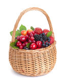Different berries in basket isolated on white background. Fresh berries in basket isolated on white background with clipping path Royalty Free Stock Photo