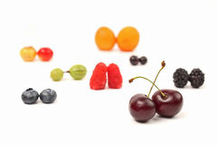 Different berries are paired on a white background. The different berries are paired on a white background Stock Photos